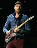 Coldplay presteert in Overleg stock fotografie