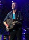 Coldplay presteert in Overleg stock afbeeldingen