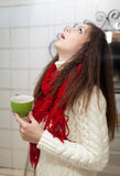 Colds girl gargles her throat Royalty Free Stock Photo