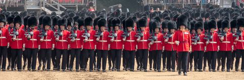 Coldstream Guards at the Trooping the Colour, military ceremony at Horse Guards Parade, London, UK. Photographed on a sunny day, showing row of soldiers in red stock photography
