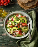 Coldwater Shrimp and Avocado Salad. A delicious coldwater shrimp and avocado salad with tomato, cucumber, celery, green onion, cilantro, and dill Stock Image