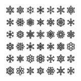 Coleção bonito do floco de neve isolada no fundo branco Os ícones lisos da neve, neve lascam-se silhueta Flocos de neve agradávei ilustração stock