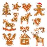A coleção das cookies do Natal com pão-de-espécie e cookies figura no fundo branco Fotos de Stock Royalty Free