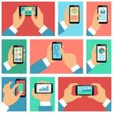 Coleção das mãos usando o telefone celular Fotografia de Stock
