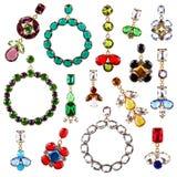 Coleção de cristal colorida bonita dos brincos isolada no branco Fotografia de Stock Royalty Free