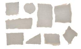 Coleção de pedaços de papel rasgados cinzentos Fotos de Stock