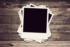 Coleção de quadros retros do Polaroid na madeira Fotografia de Stock