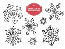 Coleção do vetor de flocos de neve tirados mão ilustração stock
