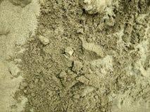 Coleção dos fundos - uma camada grossa de cimento na terra foto de stock