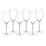 A coleção dos vidros de vinho de cristal arranjou na superfície do branco Fotografia de Stock Royalty Free