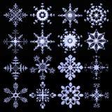 Coleção metálica elegante dos flocos de neve Fotografia de Stock