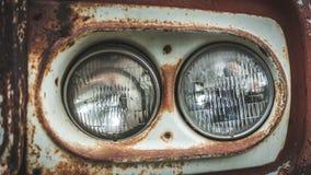 Coleção velha do carro do farol da oxidação imagens de stock royalty free