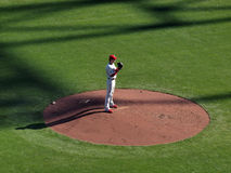 Cole Hamels stands on mound lifting glove up Royalty Free Stock Images