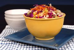 Cole slaw with carrot in a yel. Crisp cole slaw with carrot in a yellow bowl Royalty Free Stock Photos