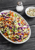 Cole slaw with seeds and pine nuts - delicious healthy vegetarian food. Royalty Free Stock Images