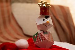 Cole up christmas paper snowman. With background royalty free stock photography