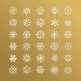 Colección blanca de los copos de nieve aislada en fondo de oro ilustración del vector
