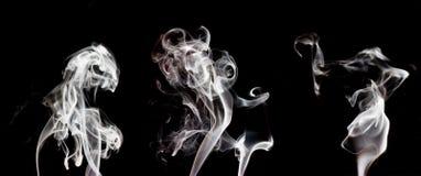Colección blanca del humo, aislada en fondo negro Fotografía de archivo libre de regalías