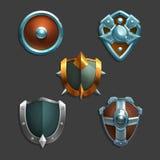 Colección de armadura de la decoración para los juegos Sistema de escudos medievales de la historieta stock de ilustración