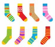 Colección de calcetines multicolores con los modelos y las rayas Fotos de archivo libres de regalías