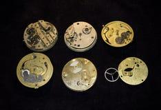 Colección de caras y de pedazos del reloj de bolsillo imagen de archivo