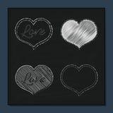 Colección de corazones blancos en el fondo de la pizarra para un Valent Foto de archivo