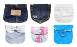 Colección de diverso bolsillo aislada en blanco. Fotografía de archivo