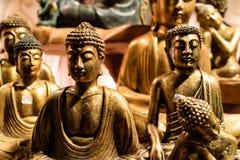 Colección de estatuas asentadas bronce de Buda Imagenes de archivo