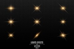 Colección de flashes, de luces y de chispas Llamaradas ópticas Luces de oro abstractas aisladas en un fondo transparente Flashe d Fotografía de archivo