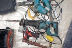 Colección de herramientas eléctricas usadas, equipo de la reparación de DIY Imagen de archivo