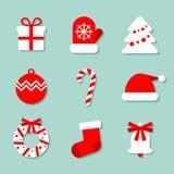 Colección de la Navidad de 9 iconos en el fondo azul: manopla, árbol de navidad, caramelo y el sombrero de Papá Noel Víspera de T fotos de archivo libres de regalías