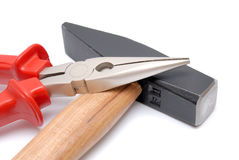 Colección de las herramientas - alicates del martillo y de la plano-nariz con las manijas rojas Imágenes de archivo libres de regalías