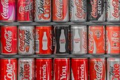 Colección de latas de la Coca-Cola Imagen de archivo libre de regalías