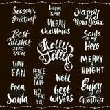 Colección de letras de la Navidad en fondo negro Saludos manuscritos Fotografía de archivo libre de regalías