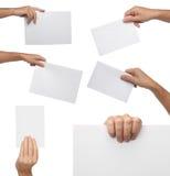 Colección de mano que sostiene el papel en blanco aislado Imágenes de archivo libres de regalías