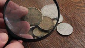 Colección de monedas almacen de metraje de vídeo