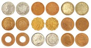 Colección de monedas indias viejas del colonial británico Fotos de archivo libres de regalías