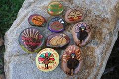 Colección de nueve pequeñas rocas pintadas para la acción de gracias Foto de archivo libre de regalías