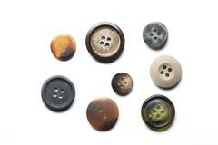 Colección de ocho botones de costura en el fondo blanco Imágenes de archivo libres de regalías
