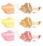 Colección de polvo del maquillaje en el fondo blanco Imagenes de archivo