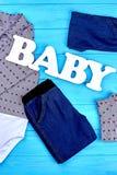 Colección de ropa de la marca para los bebés fotografía de archivo
