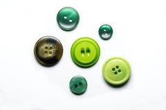 Colección de seis botones de costura en el fondo blanco Imagenes de archivo