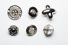Colección de seis botones metálicos Imagenes de archivo