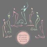Colección de siluetas estilizadas de mujeres en vestidos de noche largos Fotografía de archivo