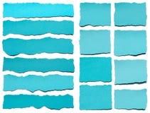 Colección de trozos de papel rasgados azules Fotografía de archivo libre de regalías