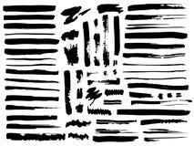 Colección del vector de diversos cepillos y de descensos Líneas negras de la brocha stock de ilustración
