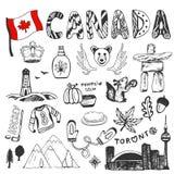 Colección dibujada mano del bosquejo de símbolos de Canadá Elementos determinados de la cultura canadiense para el diseño Ejemplo Imágenes de archivo libres de regalías