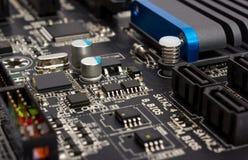 Colección electrónica - componentes digitales en mainboard del ordenador Foto de archivo libre de regalías