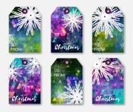 Colección festiva poligonal colorida de etiquetas de la Navidad con los copos de nieve Imagen de archivo libre de regalías