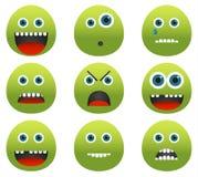 Colección de 9 emoticons verdes del monstruo Imagenes de archivo